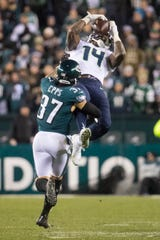 Seattle's D.K. Metcalf (14) makes a jumping catch over Philadelphia's Marcus Epps (37) Sunday night at Lincoln Financial Field. The Seahawks defeated the Eagles 17-9.