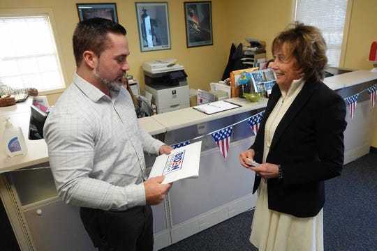 (left to right)Bo McDowell, campaign finance manager at Delaware Department of Elections, receives official paper work from Valerie Biden, sister of former Vice President Joe Biden, after she submitted it on her brother's behalf to be on the Delaware presidential ballot, Monday morning.