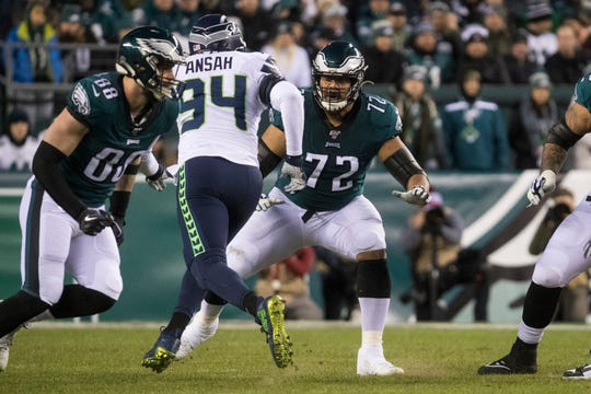 Eagles' Halapoulivaati Vaitai (72) looks for a block Sunday night at Lincoln Financial Field. The Seahawks defeated the Eagles ending their season 17-9.