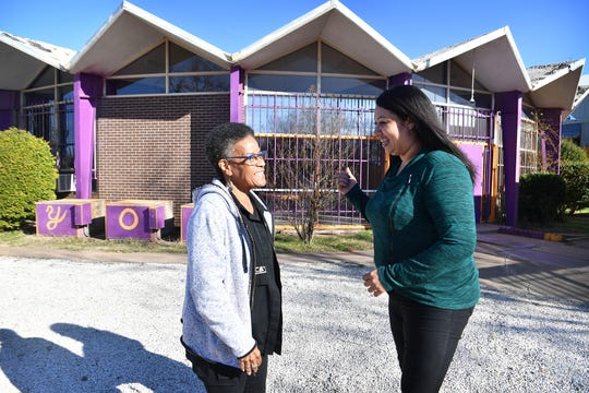 Brenda Jarrett, left, and Madeline Chappell talk outside the Youth Opportunities Center Monday.  Jarrett is retiring and Chappell is the new executive director of the YOC.