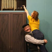 "Greg Adams as Victor gives Sarah Gantzer as Corie a boost in ""Barefoot in the Park."""