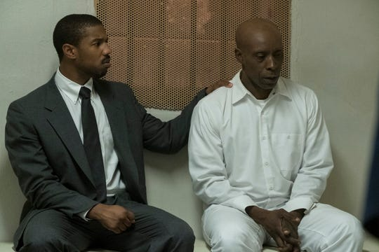 "Bryan Stevenson (Michael B. Jordan, left) comforts his client Herbert (Rob Morgan) on death row in ""Just Mercy."""