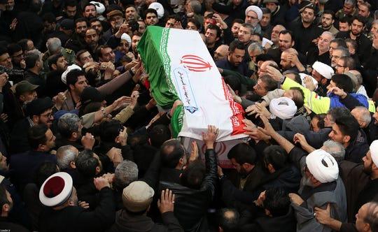 Mourners in Tehran carry the casket of slain top Iranian military commander Qasem Soleimani, on Jan. 6, 2020, after he was killed in a U.S. strike in Baghdad last week.