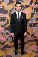 Skylar Astin posed outside the HBO party.