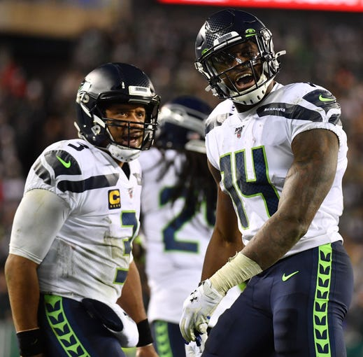 Seattle Seahawks wide receiver D.K. Metcalf (14) reacts after his touchdown.