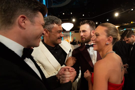 Colin Jost, Taika Waititi, Chris Evans and Scarlett Johansson had a lively chat during a Golden Globes commercial break.