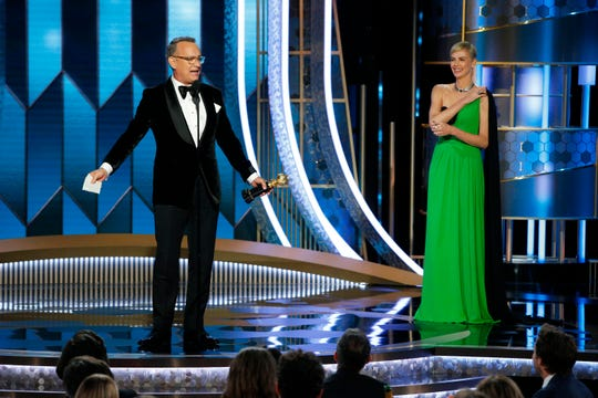 "Cecil B. DeMille award recipient Tom Hanks was introduced by Charlize Theron. His feature directorial debut, 1996's ""That Thing You Do!"" was one of her earliest roles."