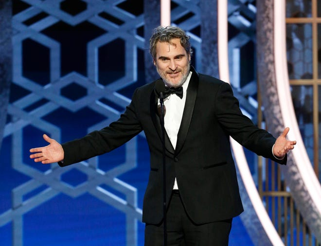 """Joaquin Phoenix accepts the award for best actor in a drama for his villainous, high-profile turn in """"Joker."""" He thanked director Todd Phillips and his fellow nominees. And he thanked the Hollywood Foreign Press Association, too, for providing a plant-based meal."""