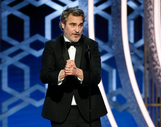 """Joaquin Phoenix accepting the award for best actor in a movie drama for his role in """"Joker"""" at the 77th Annual Golden Globe Awards."""