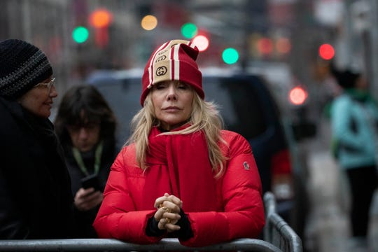 Rosanna Arquette waits outside a Manhattan courthouse for the arrival of Harvey Weinstein as his trial opens.