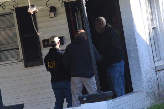 Investigators went door-to-door on Tennessee Avenue in Alexandria on Jan. 7, the day after Daniel Dewayne Aikens was arrested during a traffic stop. Aikens lives on the street, and investigators were searching his home. He faces one count of extortion for allegedly planting a pipe bomb near an Alexandria business and demanding $10,000.