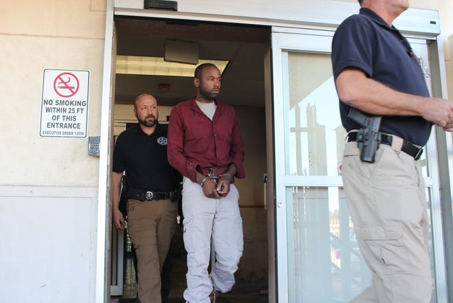 Daniel Dewayne Aikens is led out of the federal courthouse in downtown Alexandria on Tuesday afternoon. He was arrested after midnight Tuesday as an investigation into last week's explosion off MacArthur Drive continues. It wasn't immediately known what charges Aikens might be facing.