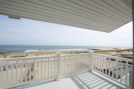 The backyard offers an expansive deck with scenic ocean views.