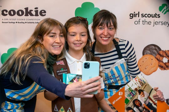 renna McCormick, 8, of Belford, a local Girl Scout who is featured on the new Girl Scout cookie packaging, poses with Shanti Mignogna and Julie Labruto of Talula's in Asbury Park as Girl Scouts of the Jersey Shore celebrate the start of the 2020 cookie season by unveiling the new cookie, Lemon-Ups, and spur competition among Jersey Shore chefs in their upcoming TopCookie dessert challenge at Salt Creek Grille in Rumson, NJ Tuesday, January 7, 2020.