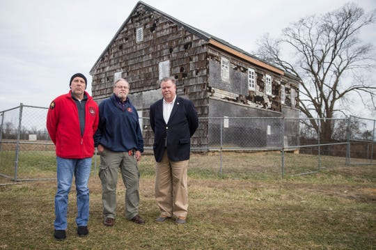 Preservationists Robert Meyer, Tom Burke and David Christoffersen stand before the Sutfin house at Monmouth Battlefield State Park.