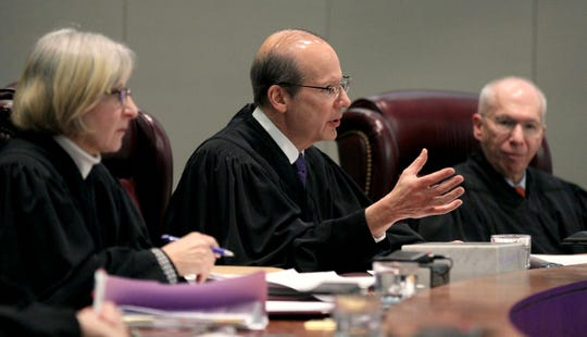 State Supreme Court Chief Justice Stuart Rabner questions former municipal court judge Richard B. Thompson, convicted in 2018 of falsifying records to maximize revenue for towns he worked for, during a hearing in Trenton Tuesday, January 7, 2020.