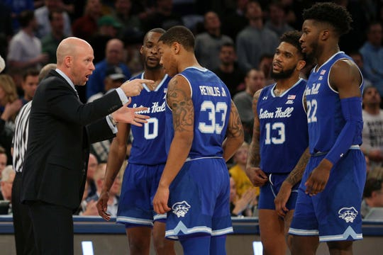 Seton Hall coach Kevin Willard speaks with his players.