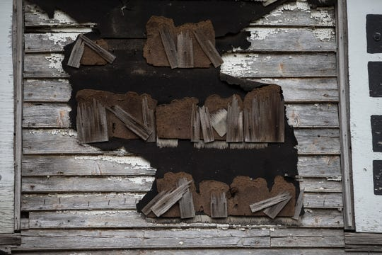 The crumbling siding of the Sutfin farmhouse at Monmouth Battlefield State Park.