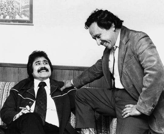 Actor and entertainer Pedro Gonzalez Gonzalez, right, enjoys a reunion with cousin Mickey Villalovos of Abilene after his arrival for the 1977 Rehab telethon.