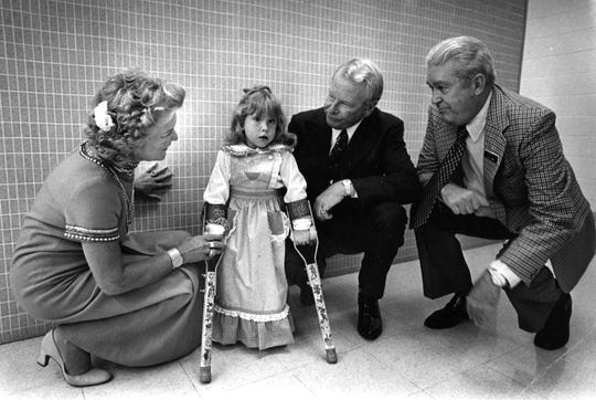 Bonnie Allen, left, Rex Allen, center, and Roff Hardy speak with Misti Hagler, 5, prior to the Rehab Center telethon in January 1976.
