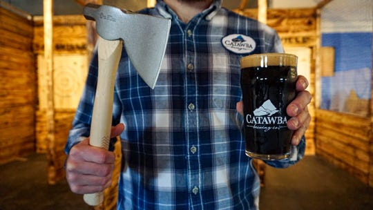 Catawba Brewing in Biltmore Village has added ax-throwing lanes to its in-house activities.