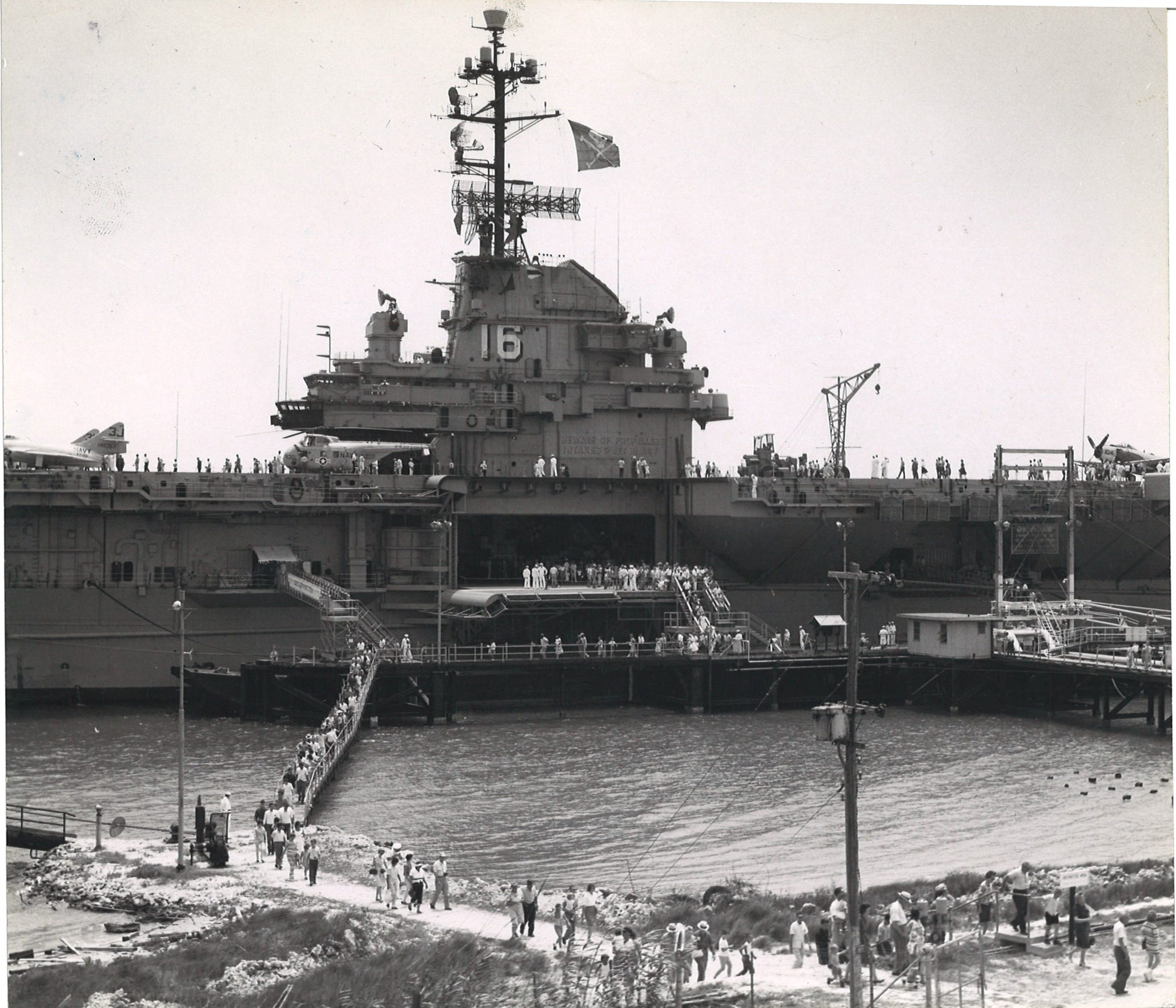 About 30,000 visitors flocked to see the USS Lexington May 3-5, 1963 when it was docked on Harbor Island in Port Aransas, Texas. The aircraft carrier was at the Humble Pipeline Co. pier.