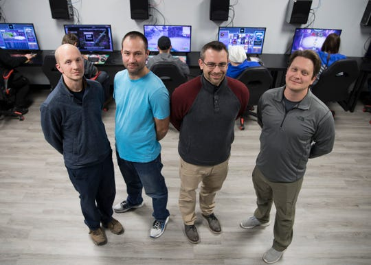 Owners of the Total Gaming Experience esports arena (L-R) Brandon Evans, Shane Matthews, Chris McCoy, and Ryan Blakeman rebranded their store from Decks and Dice after moving the location and expanding into the new frontier of esports.