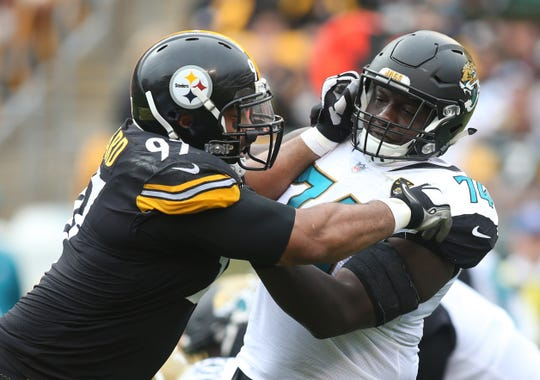 Oct. 8, 2017: Pittsburgh Steelers defensive end Cameron Heyward (97) blocks against Jacksonville Jaguars offensive tackle Cam Robinson (74) at the line of scrimmage at Heinz Field.