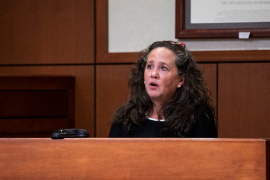 Kelly Blevins, a school liaison officer, testifies at Kenton County Family Court Judge Dawn Gentry's hearing at the Jefferson County Judicial Center in Louisville on Friday, January 3, 2020.