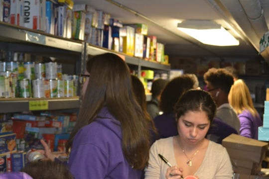 Old Bridge winter sport student-athletes organized the food pantry at the Ronald McDonald House of Long Branch