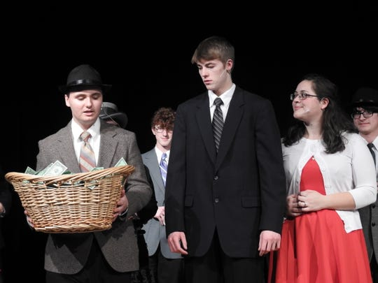 """Ian McCurdy as Uncle Billy, Blayden McCoy as George Bailey and Alexis Bamberger as Mary Bailey in Ridgewood's production of """"It's a Wonderful Life."""" Much like in the movie, the townsfolk come together and donate money to George to replace the cash Uncle Billy lost to save George's business."""