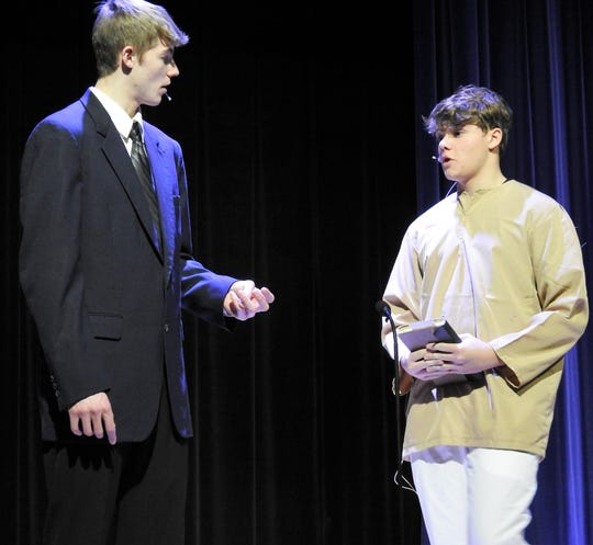 """Blayden McCoy as George Bailey and Rocye Shaffer as Clarence Oddbody rehears a scene from """"It's a Wonderful Life"""" opening Thursday at Ridgewood High School. The play is based on the classic film about a man who discovers what the world would have been like if he had never been born."""