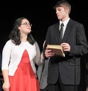 """Alexis Bamberger as Mary and Blayden McCoy as George rehearse a scene from """"It's a Wonderful Life"""" at Ridgewood High School. They take on roles played in the classic film by Donna Reed and Jimmy Stewart."""
