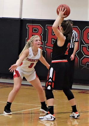 Coshocton's Keeley Murray guards Ridgewood's Kalie Rettos in a game from last season. Murray is the Lady 'Skins returning scorer as they enter the MVL Small School Division this season.