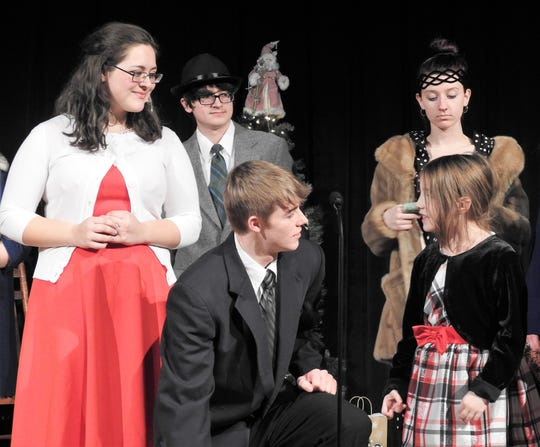 """Alexis Bamberger as Mary and Blayden McCoy as George star in """"It's a Wonderful Life"""" playing Thursday at Ridgewood High School. There will be a public performance in the evening and one in the morning as part of the annual luncheon for area senior citizens."""
