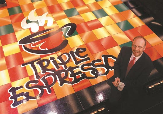 """2002. Jeff on the """"Triple Espresso"""" stage at the Temple Theater. """"Triple Espresso"""" –A Highly Caffeinated Comedy launches the new Temple Theater in Des Moines' western gateway. Initially scheduled for an 8-week run, the popular three-person show captured the hearts of more than 88,000 attendees over its 16-month record-setting engagement."""