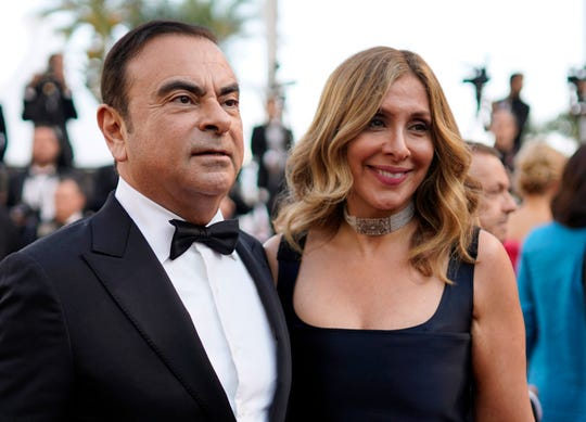 Former Nissan Motor Co. Chairman Carlos Ghosn and his wife Carole Ghosn arrive for a screening at the 71st annual Cannes Film Festival, in Cannes, France May 11, 2018.