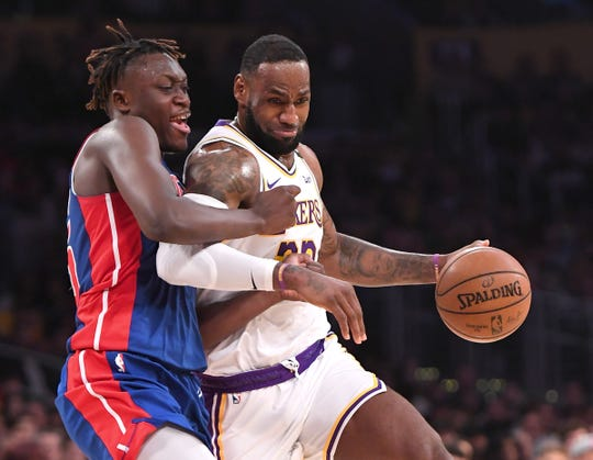 Sekou Doumbouya defends LeBron James on a drive Sunday at Staples Center in L.A.