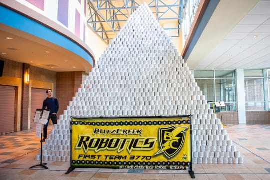 People involved in the Bullock Creek High School Robotics team prepare to take down the world's largest toilet paper pyramid on Monday, Jan. 6, 2020. Bullock Creek High School's Robotics team built the world's largest toilet paper pyramid and are selling the toilet paper back to the community for a discounted price as a fundraiser for the team.