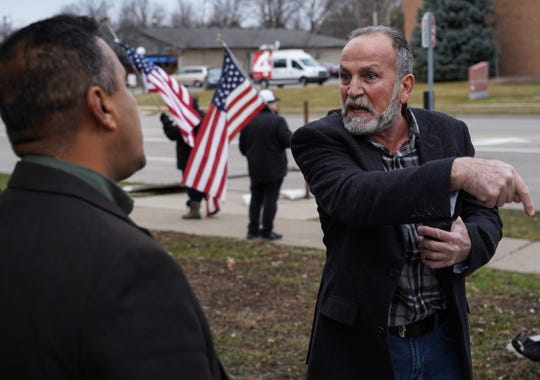 Khaled Somo, right, argues with another man against people giving their condolences for Iranian Major Gen. Qassem Soleimani, who was killed in a U.S. airstrike in Baghdad, at the Consulate General of the Republic of Iraq in Southfield on Tuesday.