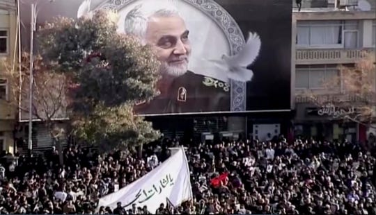 In this image made from a video, mourners gather to pay their respects to the slain Gen. Qassem Soleimani who was killed in a U.S. airstrike, in Kerman, Iran Tuesday, Jan. 7, 2020.
