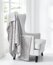 Juicy Couture offers throws for a cozy winter.