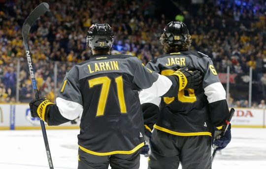 Red Wings forward Dylan Larkin, left, congratulates Panthers forward Jaromir Jagr after Jagr scored a goal during an NHL All-Star semifinal in Nashville in 2016.