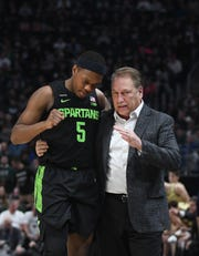 Michigan State point guard Cassius Winston (5) has a chance to become the first college player to finish with more than 2,000 points and 1,000 assists.