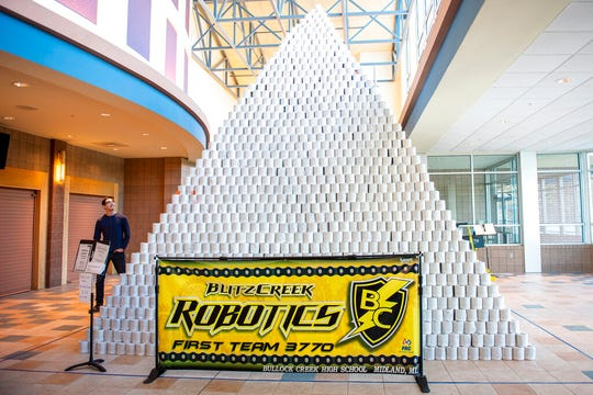People involved in the Bullock Creek High School Robotics team prepare to take down the world's largest toilet paper pyramid on Monday, Jan. 6, 2020.