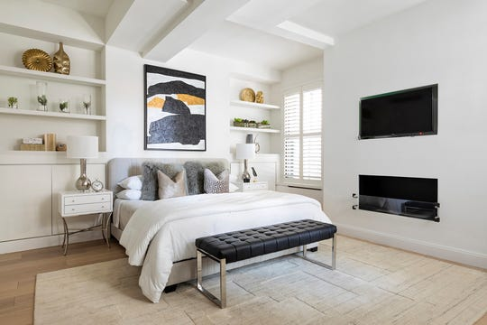 A master bedroom is updated with artwork and accessories.