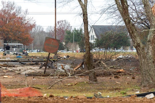 A view of the burnt wreckage of a small plane that crashed into the parking lot of a post office is shown in Lafayette, La., Saturday, Dec. 28, 2019. A small plane carrying a group of sky divers crashed Saturday in south-central Louisiana, killing three people and injuring two others on board.
