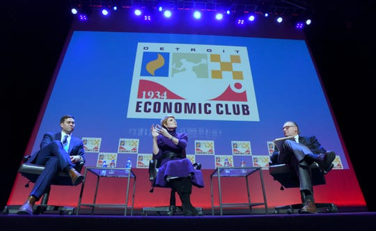 Jeff Donofrio, Michigan Department of Labor and Economic Opportunity director, left, and Diane Swonk, Grant Thornton chief economist, center, answer questions from moderator Daniel Howes, a columnist and associate business editor at The Detroit News.