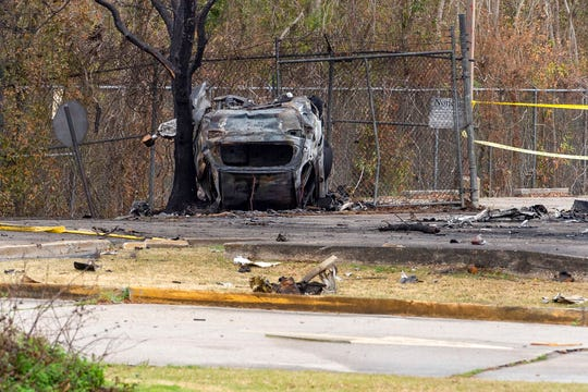 A view of a damaged vehicle near the site of the plane crash.