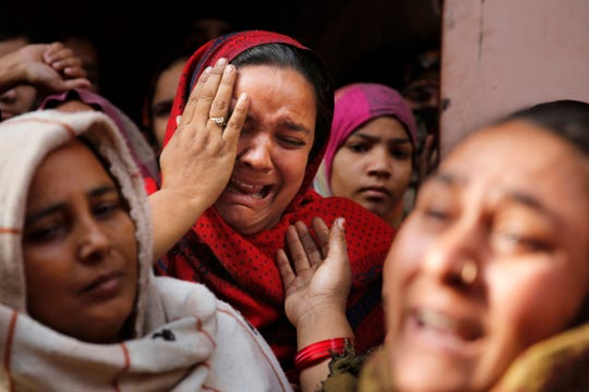 The sister of Mohsin Ahmad, a laborer who was shot and killed allegedly in police firing during protests against Citizenship Amendment Act, cries Dec. 24, 2019, outside her residence in Meerut, India